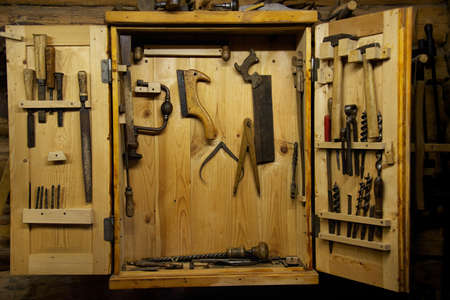 Wooden toolbox on a wall photo