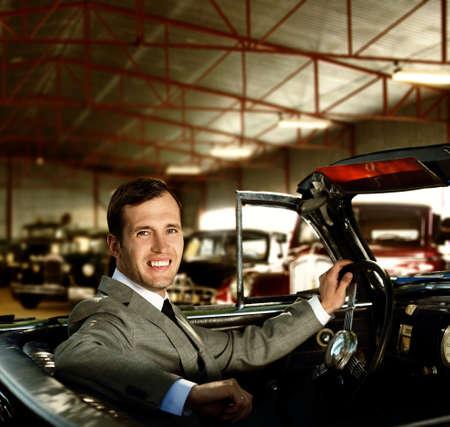 Man behind wheel in a retro car Stock Photo - 14731863