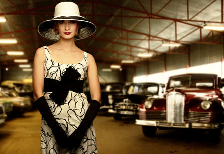 antique car: Woman in hat in retro garage