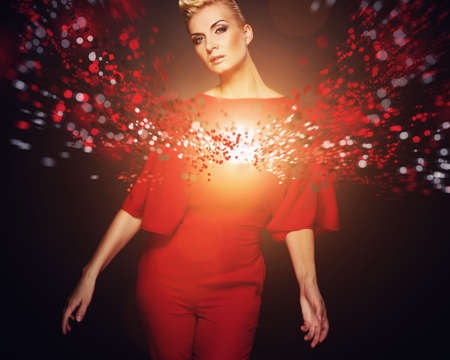 Conceptual picture of a fashionable woman in red  photo