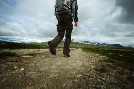 back view man: PIcture of a hiker walking