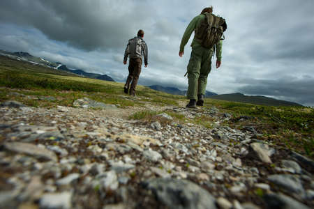 walking pole: PIcture of a two hikers walking