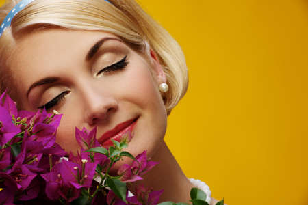 Lovely woman  with a flowers portrait Stock Photo - 15183066