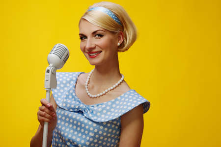 Woman singer in blue dress photo