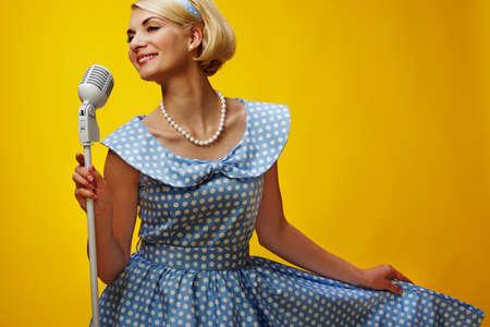 Woman singer in blue dress Stock Photo - 15183065