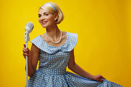Woman singer in blue dress Stock Photo - 15183064