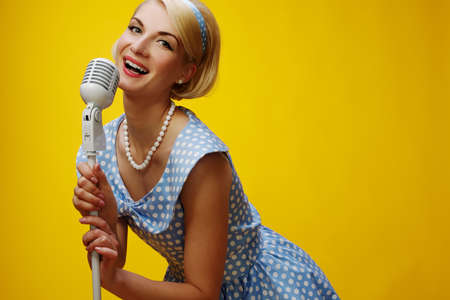 Woman singer in blue dress Stock Photo - 15183062