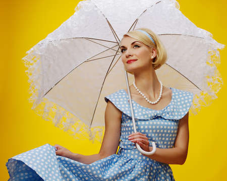 Woman in blue dress with a parasol Stock Photo - 15183061