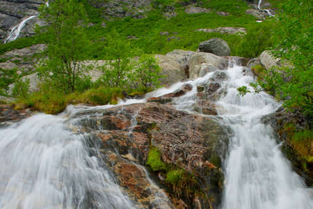 Fast cascade in norwegian mountains  photo