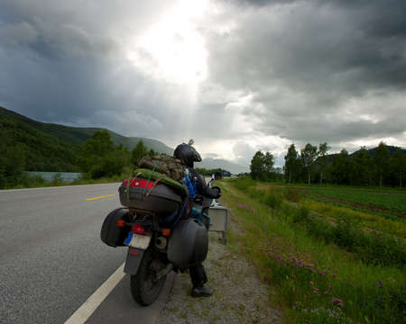 Motorcycle traveler with luggage photo