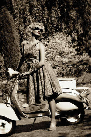 Woman in retro dress with a scooter Stock Photo - 15076813