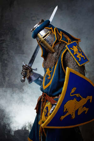 blue grey coat: Medieval knight on abstract background Stock Photo