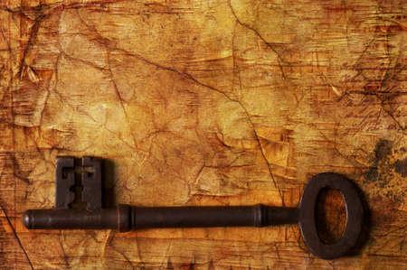old key: Old key on wooden background