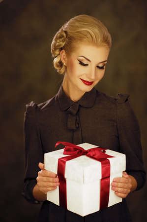 Retro woman with a gift box photo