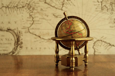 Globe  against map on a wall photo