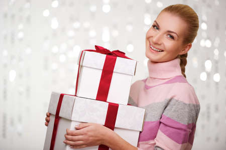 woman sweater: Smiling woman in cashmere sweater with gift boxes Stock Photo