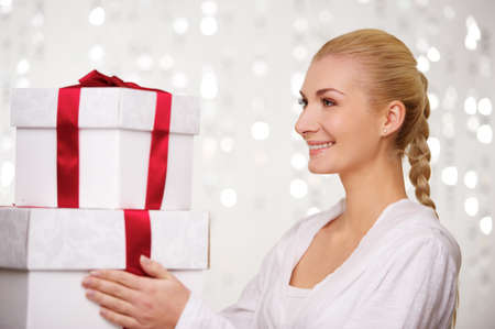 Smiling woman with gift boxes photo