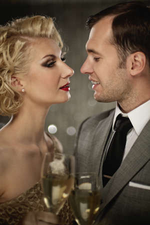 Retro couple with glasses of champagne Stock Photo - 15076732