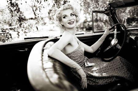 Smiling retro woman in convertible Stock Photo - 15076783