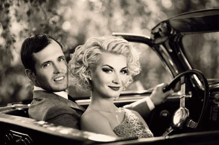 Retro couple in convertible photo