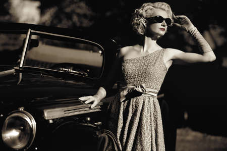 Woman near a retro car outdoors photo