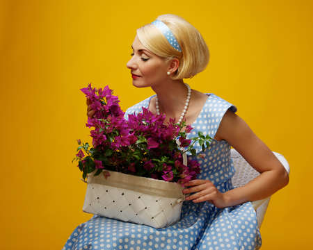 Lovely woman in a blue dress with a flowers Stock Photo - 15076823