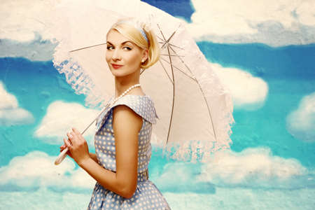 Woman with parasol against drawn sky Stock Photo - 15076819
