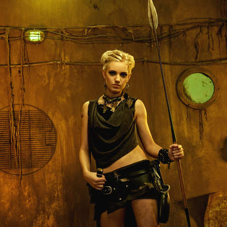 Woman with a spear in a bunker photo