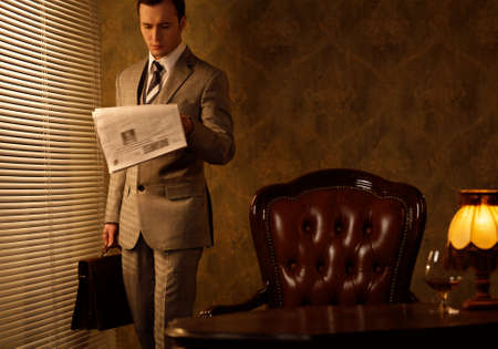 Retro businessman reading newspaper Stock Photo - 15473245