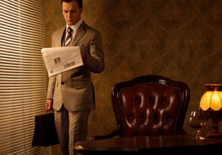 Retro businessman reading newspaper Stock Photo - 15473245