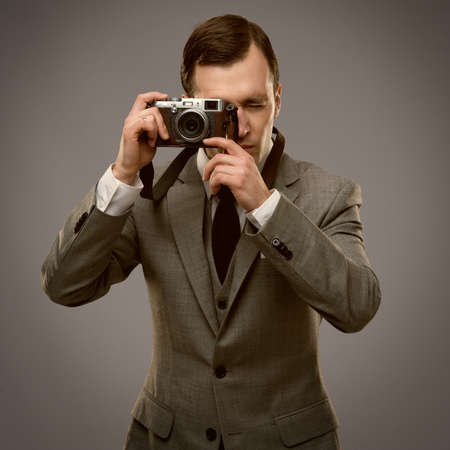 Businessman with a retro camera  photo