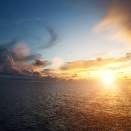 Beautiful sunset over an ocean photo