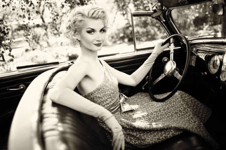 Retro woman in convertible Stock Photo - 15473347