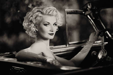 Retro woman in convertible Stock Photo - 15473333