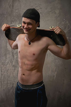 Young man with a skateboard  photo