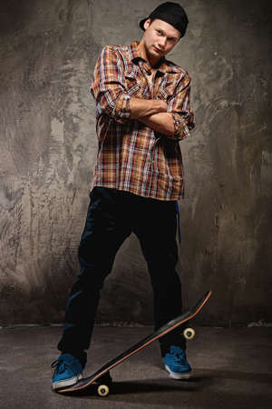 skateboarding tricks: Young man with a skateboard  Stock Photo