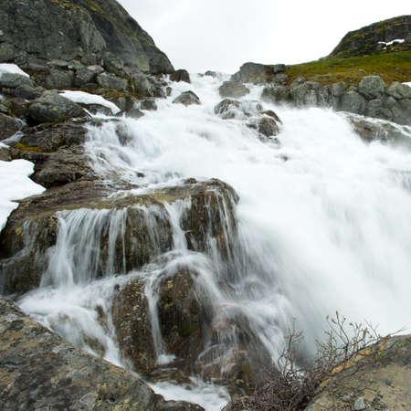 Waterfall in scandinavian mountains photo