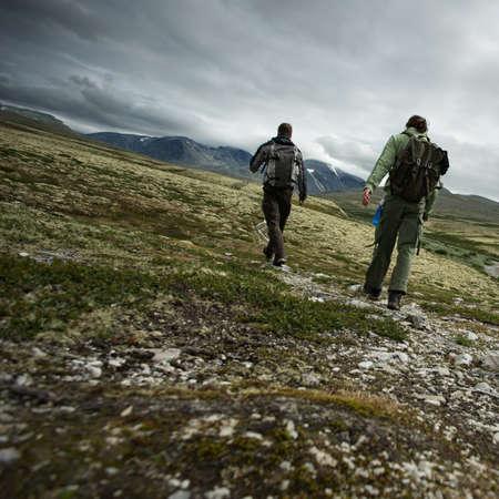 Two hikers walking