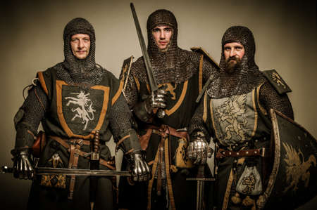 chain armour: Three medieval knights Stock Photo