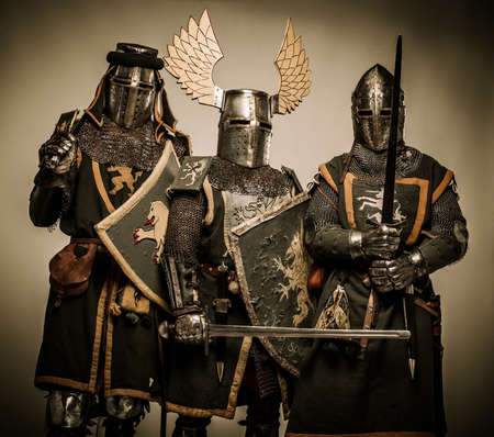 armored: Three medieval knights Stock Photo