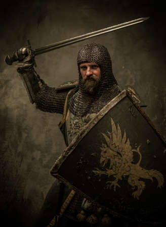 hauberk: Medieval knight in attack position Stock Photo