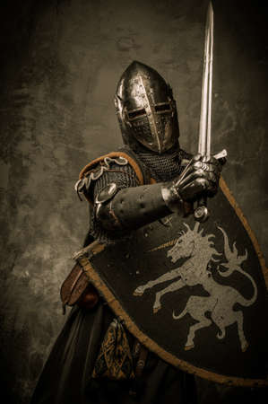 Medieval knight on grey background Stock Photo