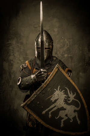 Medieval knight on grey background photo