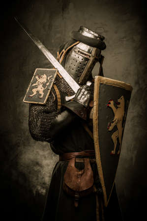 Medieval knight with a sword photo