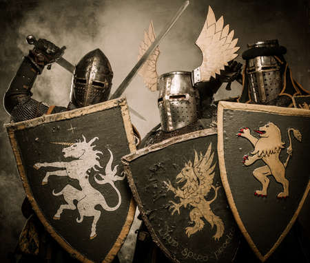 combative: Three medieval knights Stock Photo