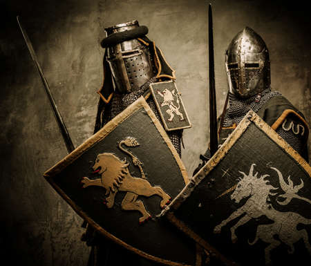 Medieval knights on grey background photo