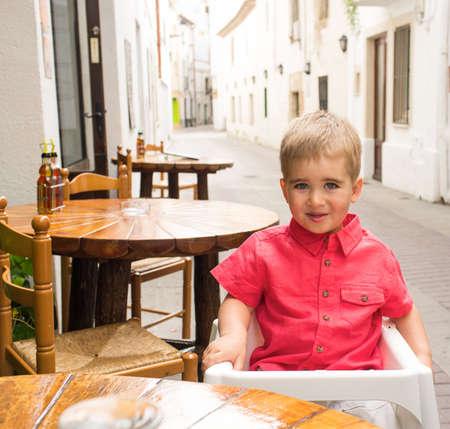 Little boy in steet cafe Stock Photo - 16012289