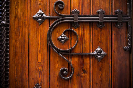 closed door: Wooden door with metal decoration