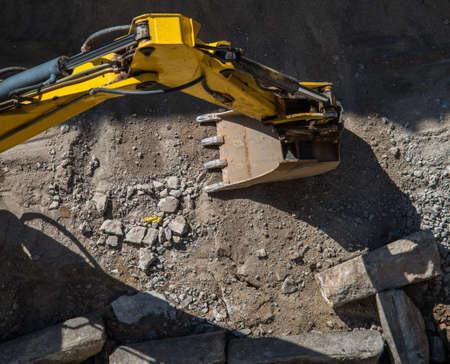 backhoe loader: Excavator in work  Stock Photo