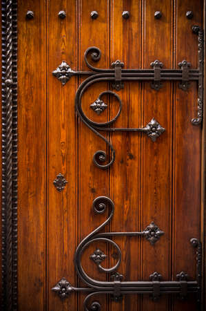 door bolt: Wooden door with metal decoration